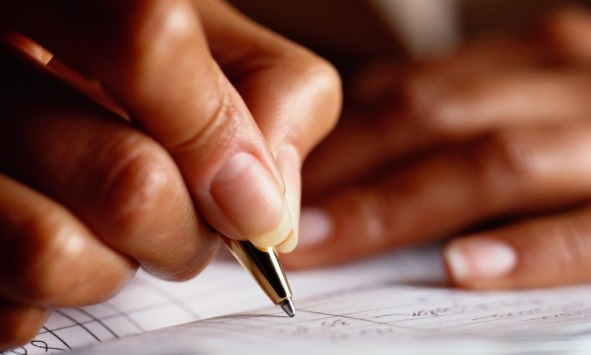 woman-writing-check